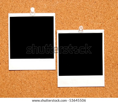 two blank instant film photographs tacked to a bulletin board