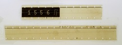 two blank long 16mm filmstrips or snips on white fixed by transparent sticky tape