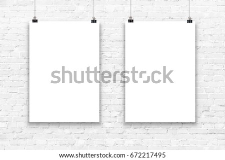Two blank paper poster mockup on a white brick wall.  #672217495