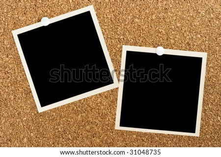 Two blank photos posted on cork board