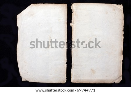 two blank sheets from a ancient book from almost 300 years old isolated on black