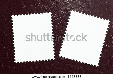 Two blank stamps on a red leather background