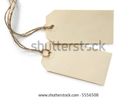 Two blank tags, tied with string, reflected on white surface.