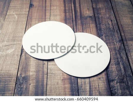 two blank white beer coasters...