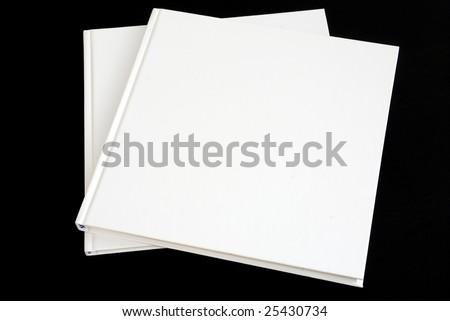 Two blank white books isolated on black waiting for your design