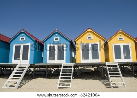 two blue and two yellow beach-houses