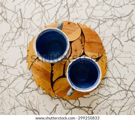 Two blue cups for tea time on the home kitchen table