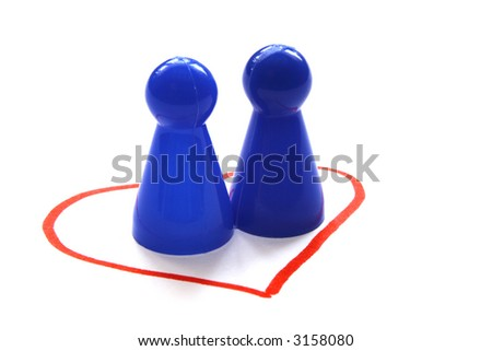 Two blue game figurines in a heart, symbolizing the concept of same-sex love, homosexuality
