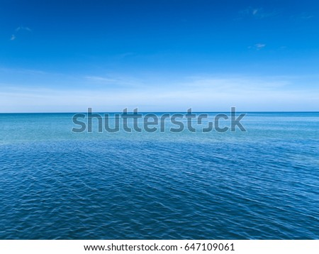 Two blue halves. Blue ocean and blue sky in tropical Thailand #647109061