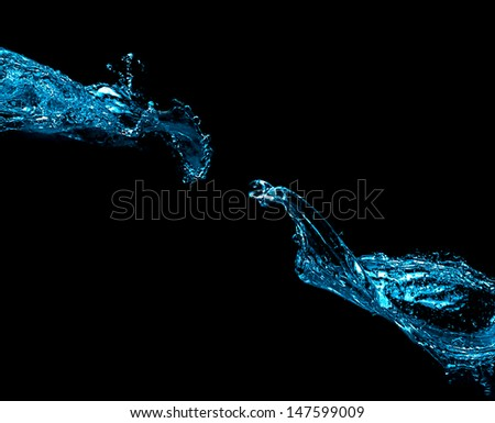 Two blue water splash isolated on black background