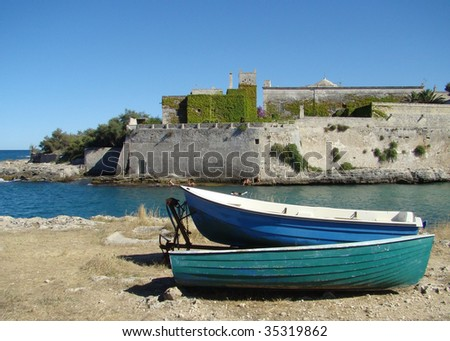 two boats and castle Santo Stefan, Puglia, Italy
