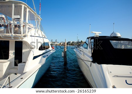 Two boats on dock. Blue Caribbean water in Mexico