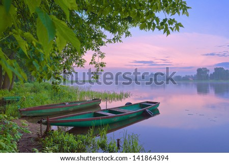 Two boats on Narew river. Sunrise landscape.