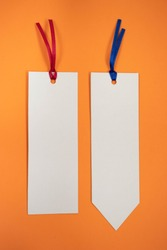 Two bookmarks on an orange background