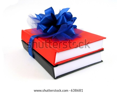 Two books wrapped with a blue ribbon on white background
