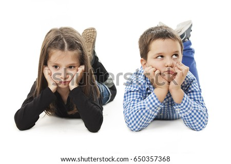 Two bored kids lying on the white background