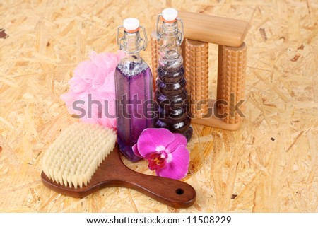two bottles of cosmetic and orchid flower
