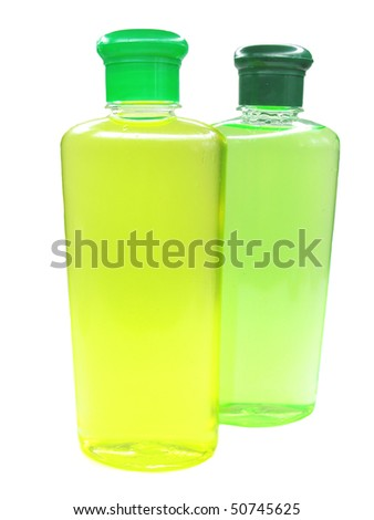 two bottles of herbal shampoo yellow and green