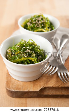 Two Bowls of Healthy Seaweed Salad Sprinkled with Sesame Seeds