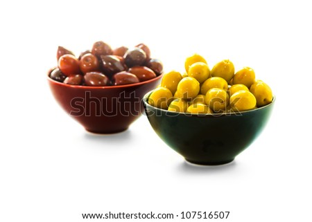 Two bowls of olives, shallow depth of field - stock photo