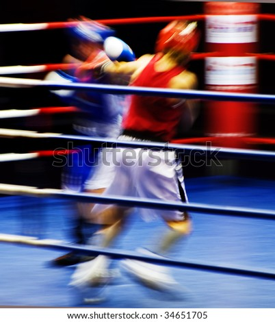 Two boxers fighting at the ring