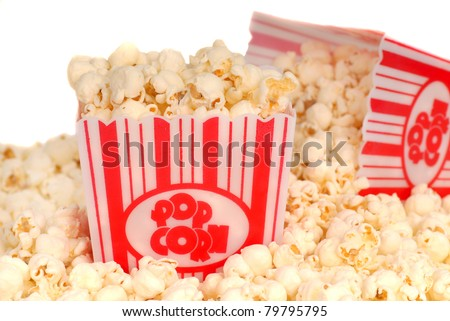 Two boxes of delicious movie popcorn with popcorn spilling out