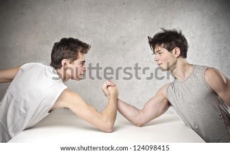Two boy arm-wrestling