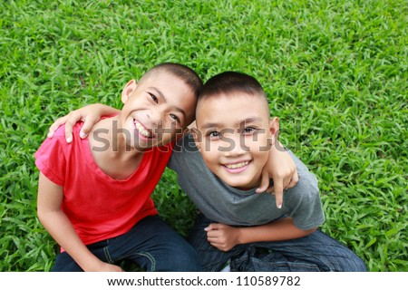 Two boy having good time in the park.