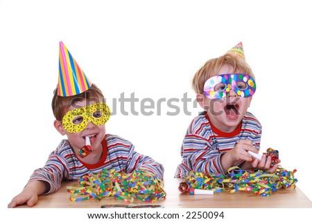two boys celebrate birthday isolated on white