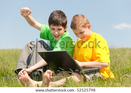 Two boys has got a computer victory and show their feelings about it