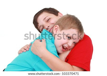 Two boys hugging
