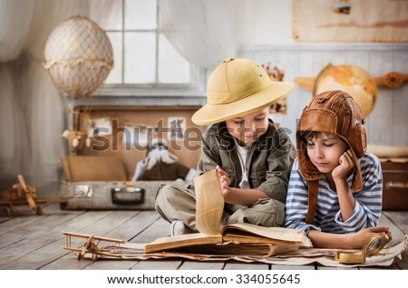 Two boys in the pilot study and the tourist old book travel