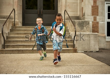 Two boys leaving school happy