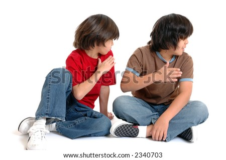 Two boys slapping their faces at the same time
