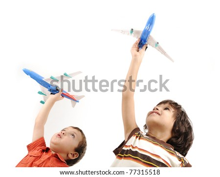 Two boys with airplanes in hands