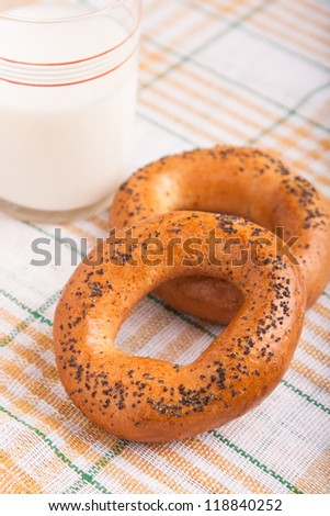 two bread-ring with milk on napkin