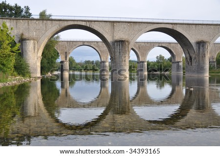 Two bridges crossing the river in perfect harmony
