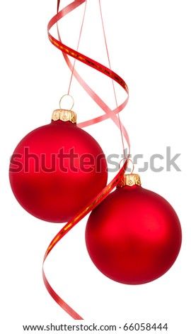 Two bright red Christmas tree balls with curly ribbons isolated on the white background