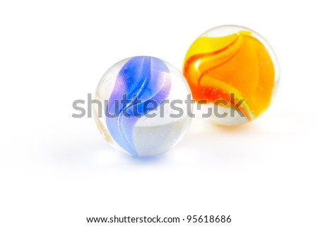 Two brightly colored glass marbles isolated on white