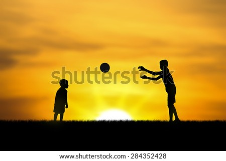 two brothers, boys play at sunset.