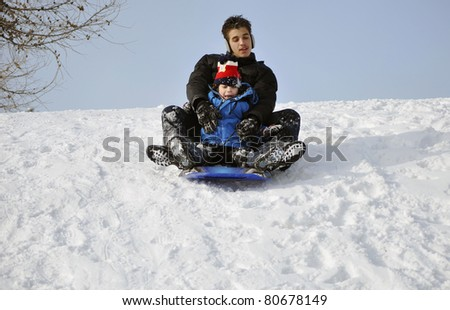 Two brothers have fun in a park during winter