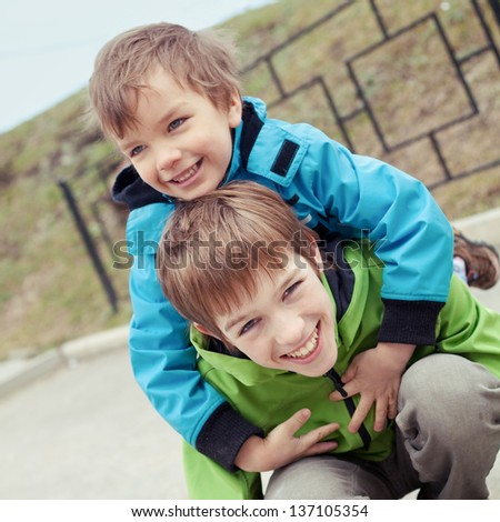 Two brothers laugh, outdoor