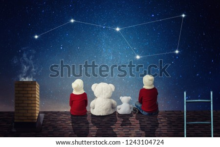 Two brothers sit at night on the roof with toy bears and look at the constellation Ursa Major.
