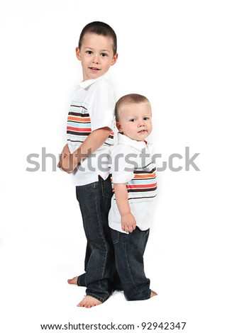 Two Brothers standing next to each other on white background
