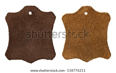 Two brown leather labels isolated on white. Each one is shot separately. Top view