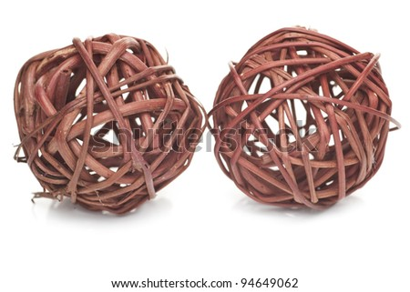 Two brown spheres made from wicker isolated on white