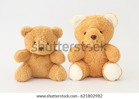 two brown teddy bears look cute ...