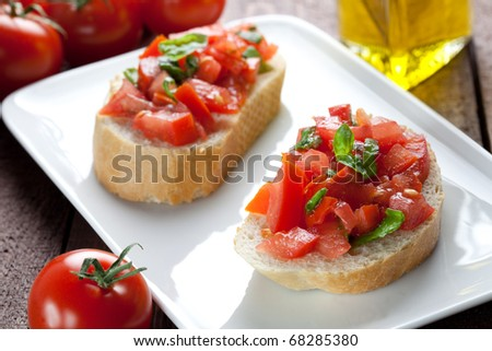 two bruschetta with tomato and basil