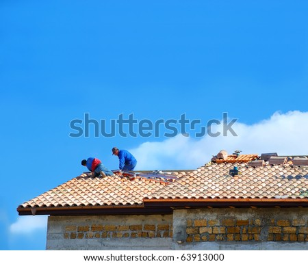 Two builders on the roof