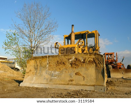 Two bulldozers parked at the construction site